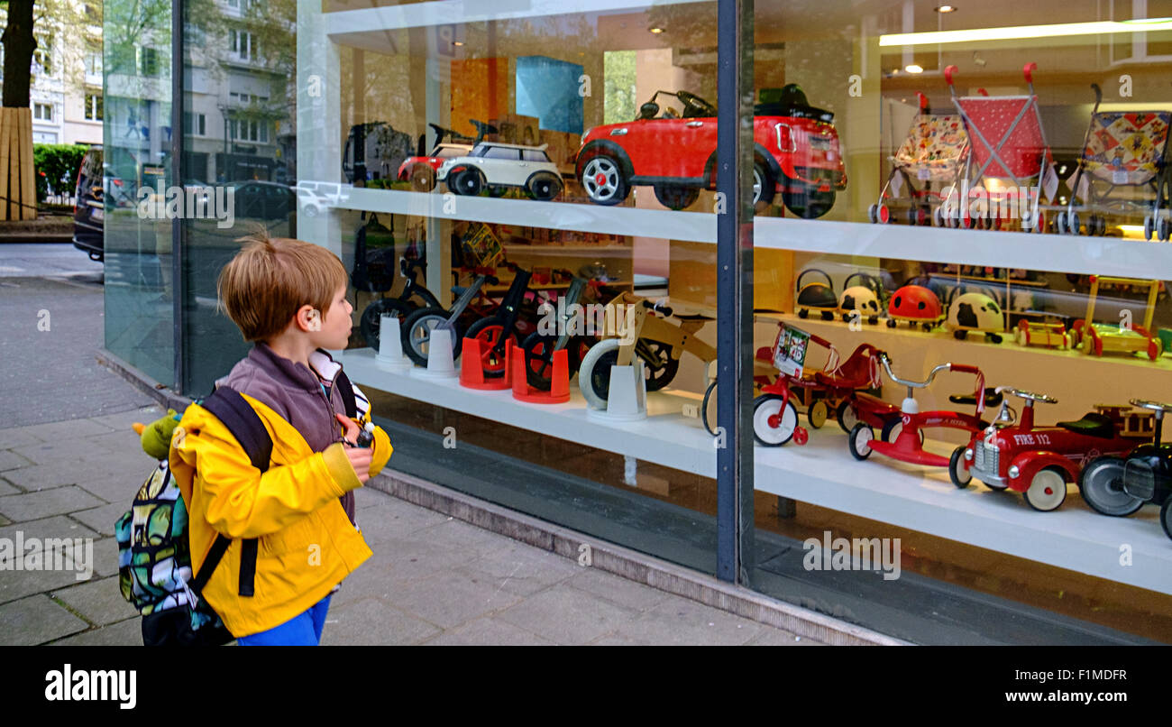 boy kid child desire look looking toyshop window - Stock Image