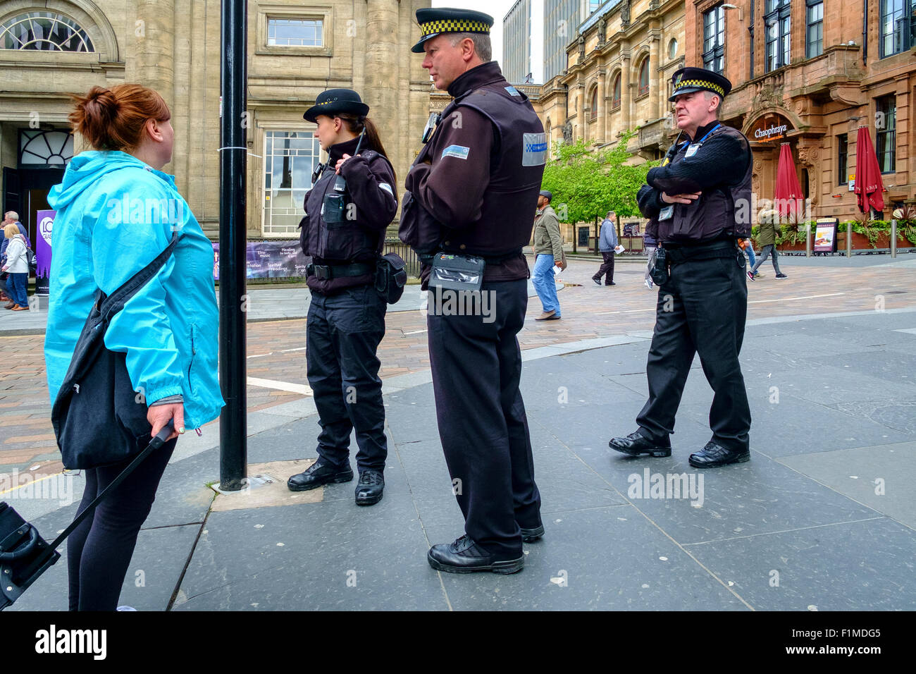 uk police officers patrolling street member public - Stock Image