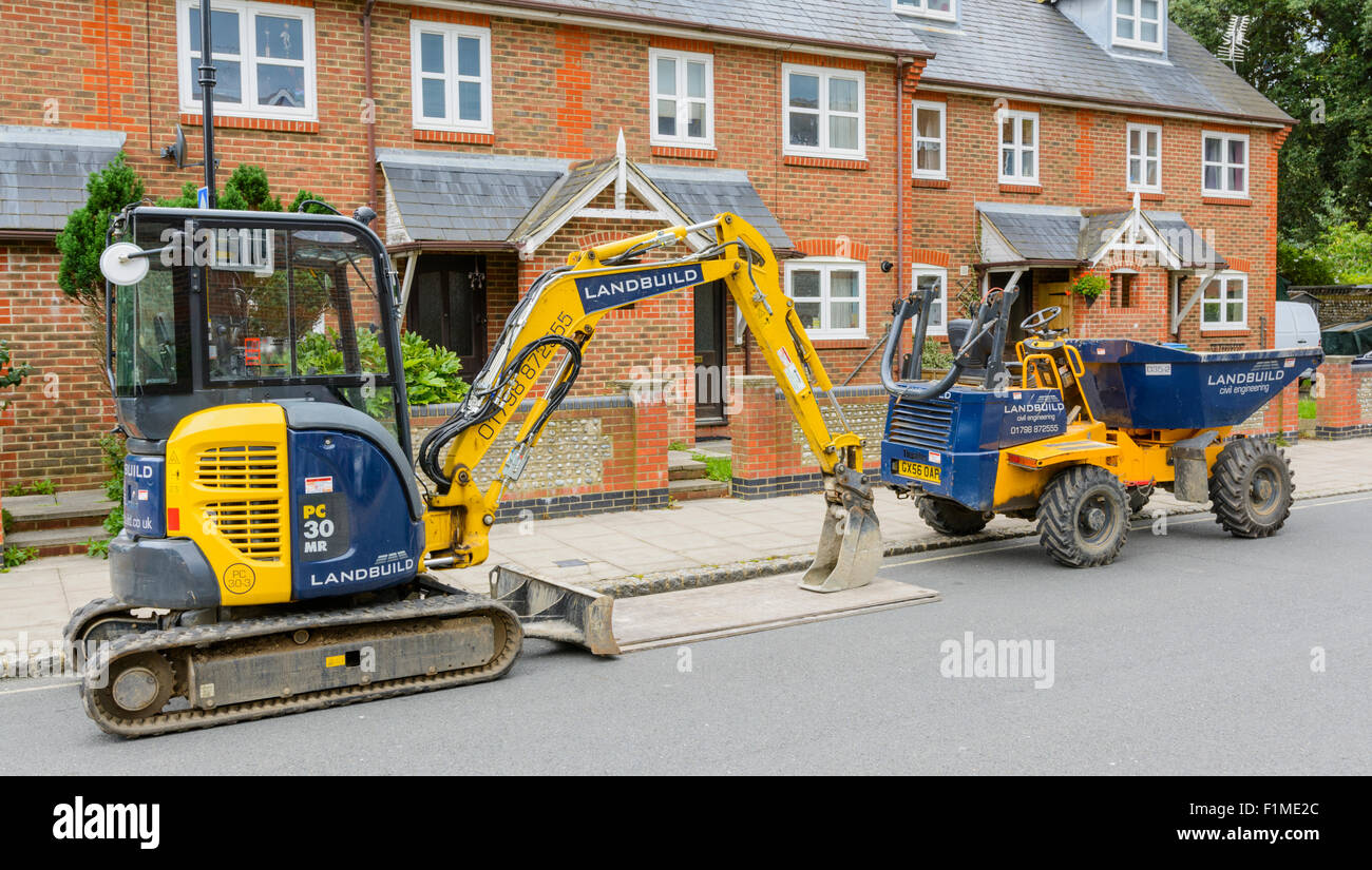 Thwaites and Landbuild construction machinery left at the side of the road. - Stock Image