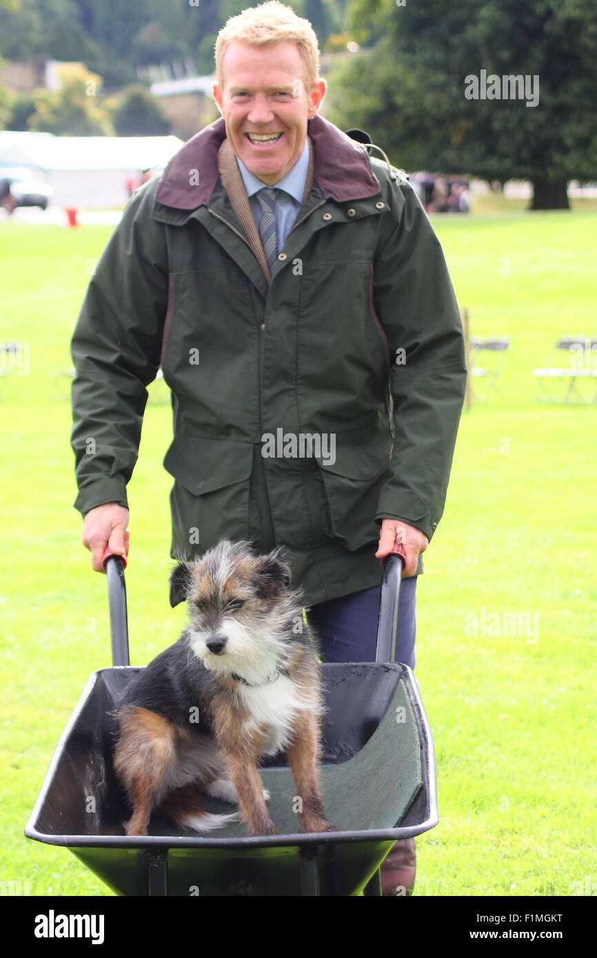 Peak District, Derbyshire, UK. 4 Sept 2015. Farmer and BBC Countryfile presenter, Adam Henson tries out racing dogs - Stock Image