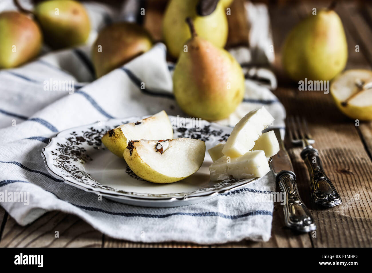 Coscia pears with slices of italian asiago cheese. - Stock Image