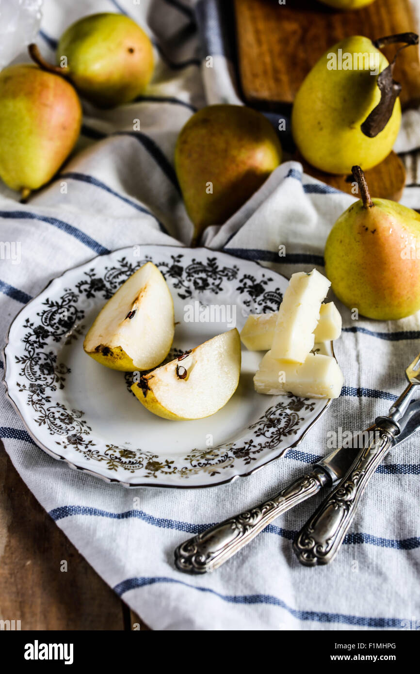 Ripe 'coscia' pears and italian cheese sliced on wooden table. - Stock Image