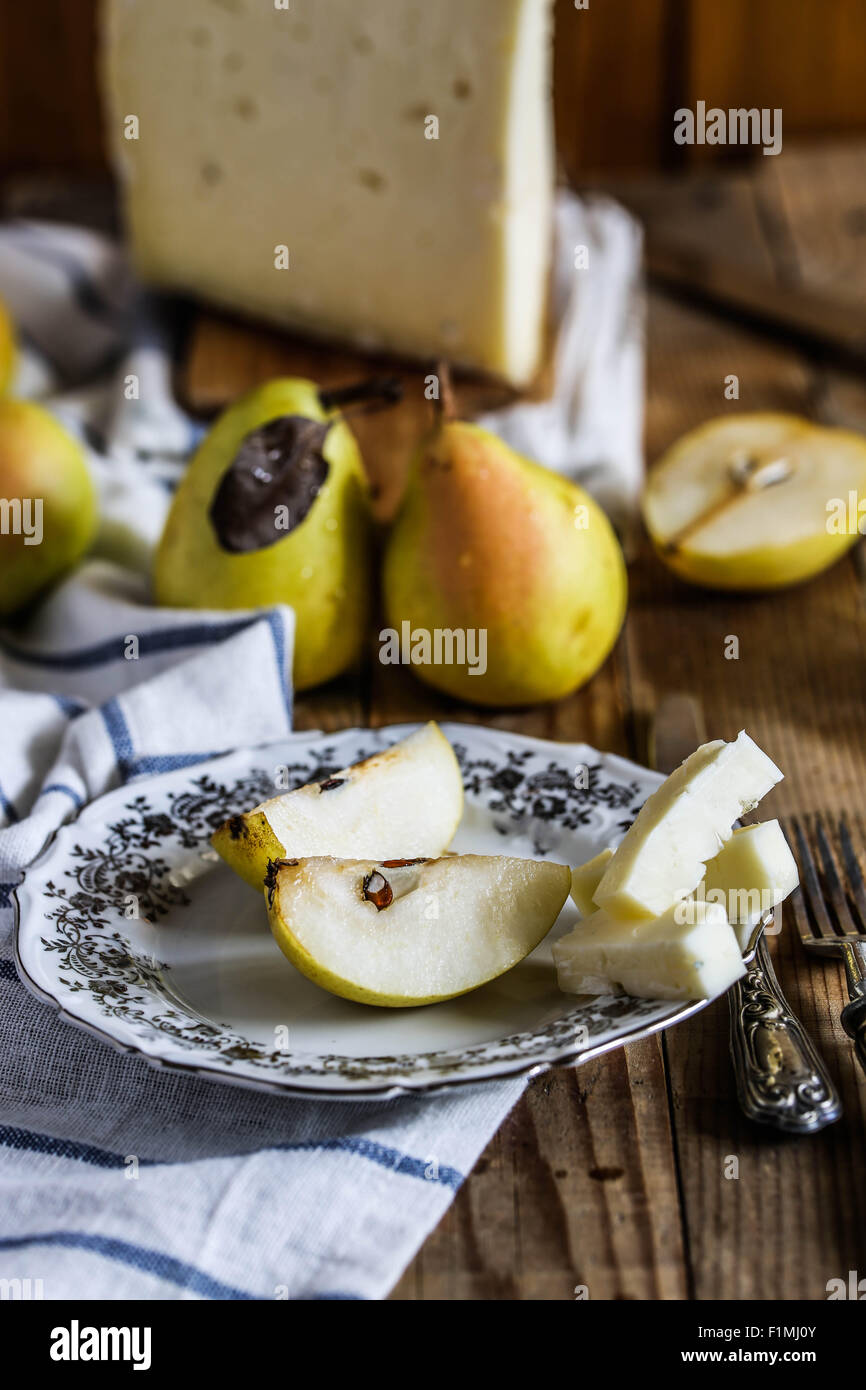 Slices of pears and italian 'Asiago' cheese. - Stock Image