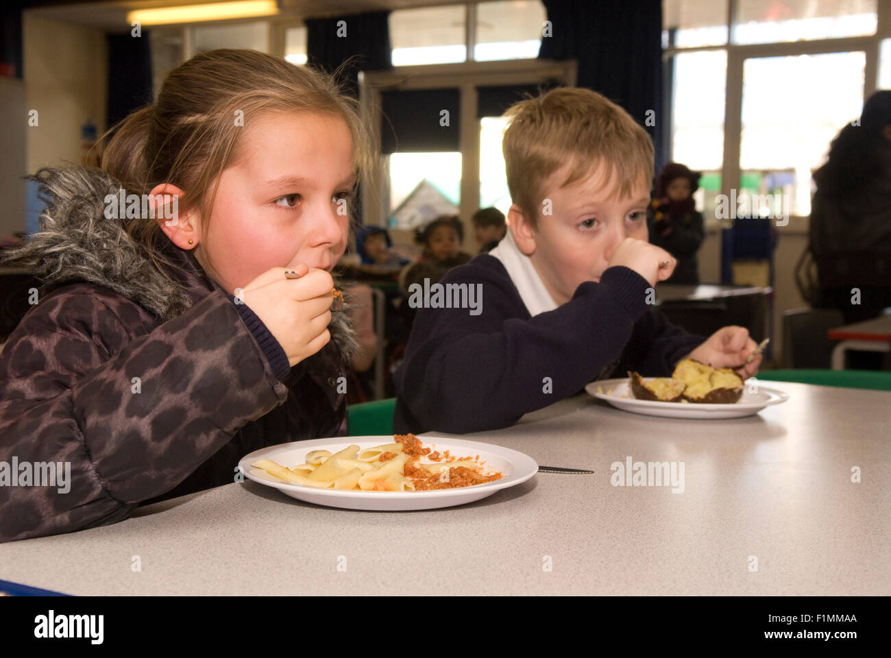 Primary school pupil's having their lunch, London, UK. Stock Photo