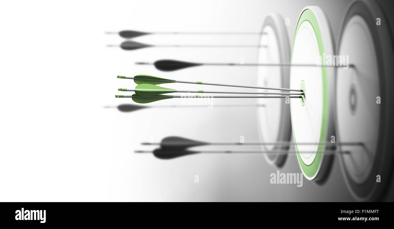Three targets with focus on the one in the center and arrows hitting the center. Concept of competitive excellence - Stock Image