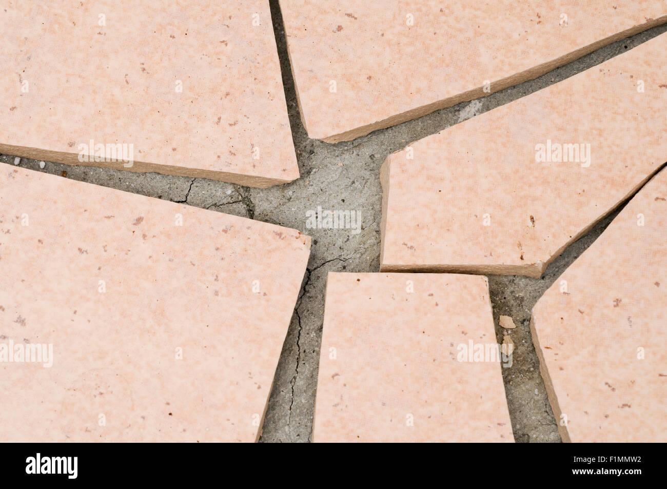 broken floor tiles - Stock Image