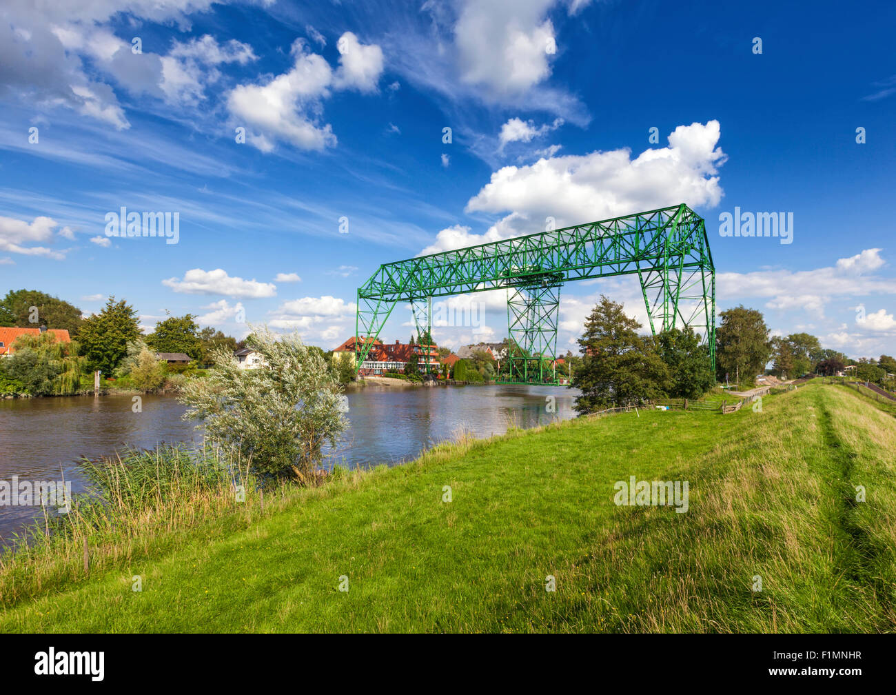 Historic transporter bridge across the Oste river and Osten village, wide angle view - Stock Image