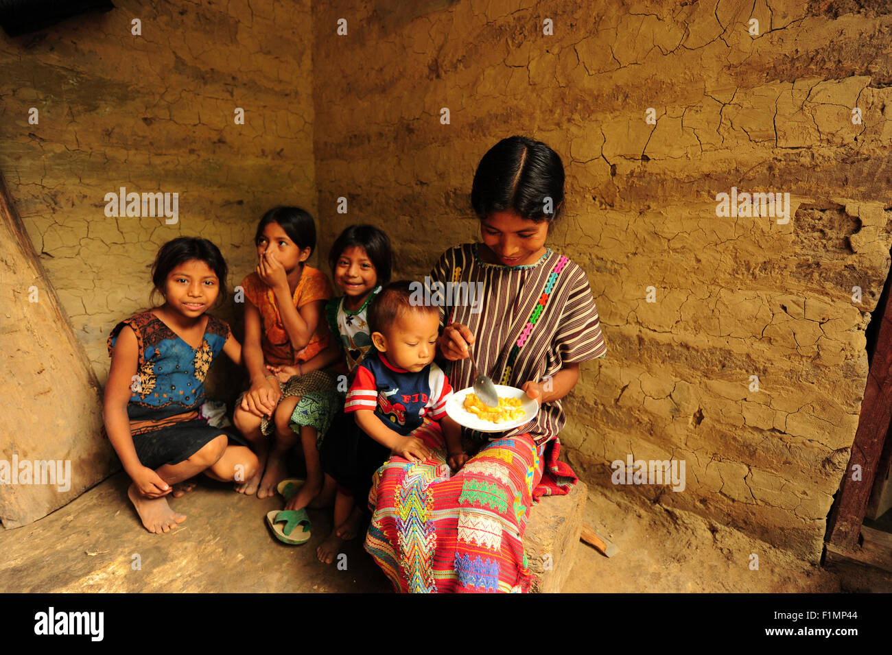 Guatemala, la Democratia, mother (Andrea Mendez Hernandez 33) preparing Macrovital chispitas for baby (Horacio Lopez - Stock Image