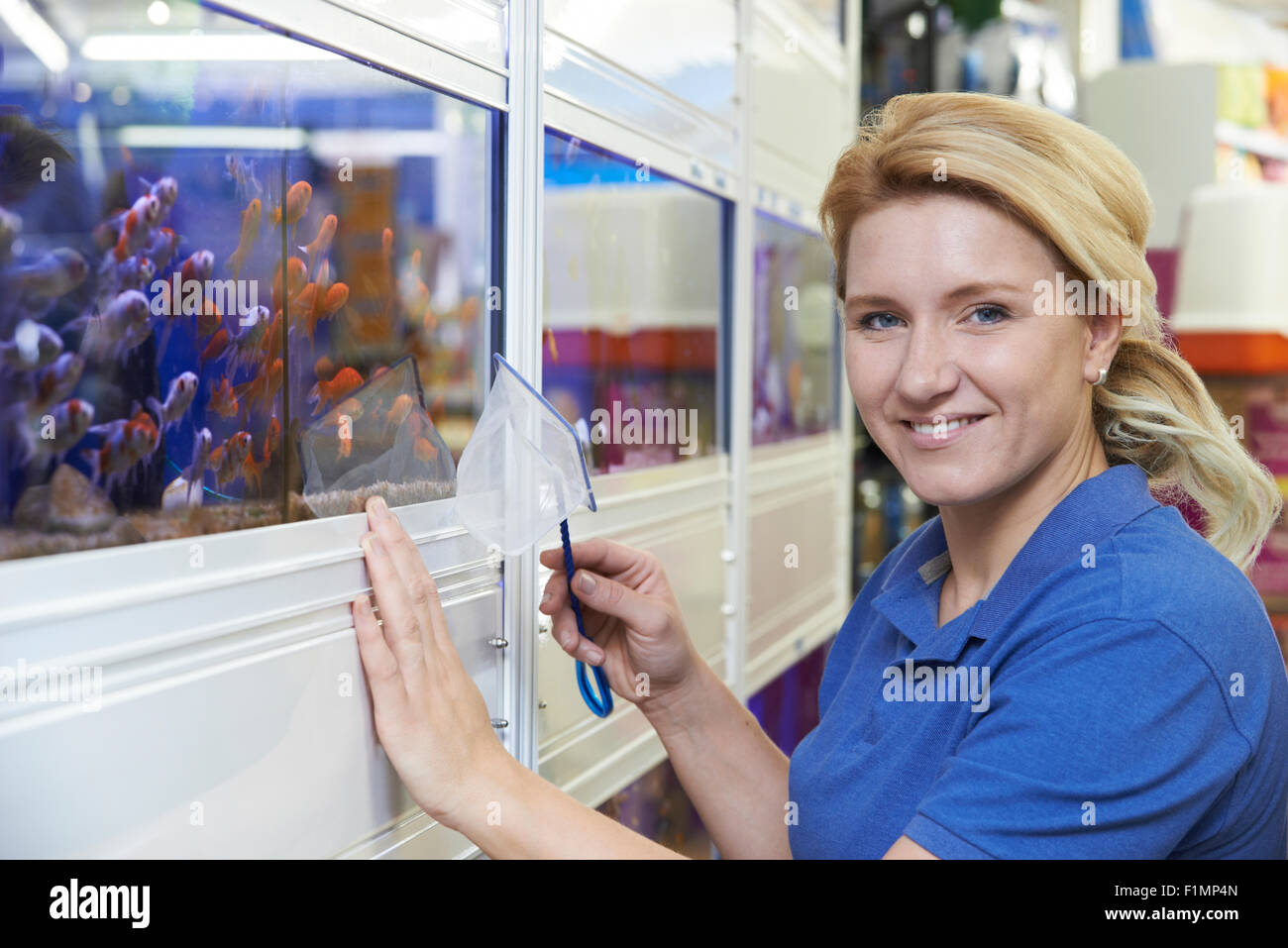 Portrait Of Female Employee In Pet Store - Stock Image