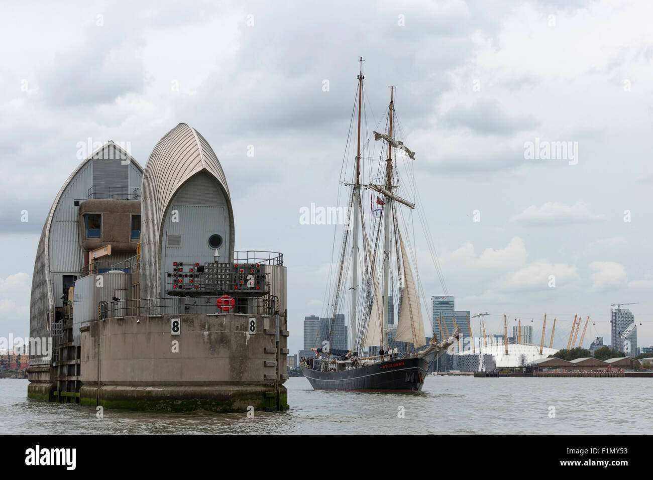 Royal Greenwich Tall Ships Festival 2015 on the River Thames with tall ship Wylde Swan (NL) passing the Thames Barrier, - Stock Image
