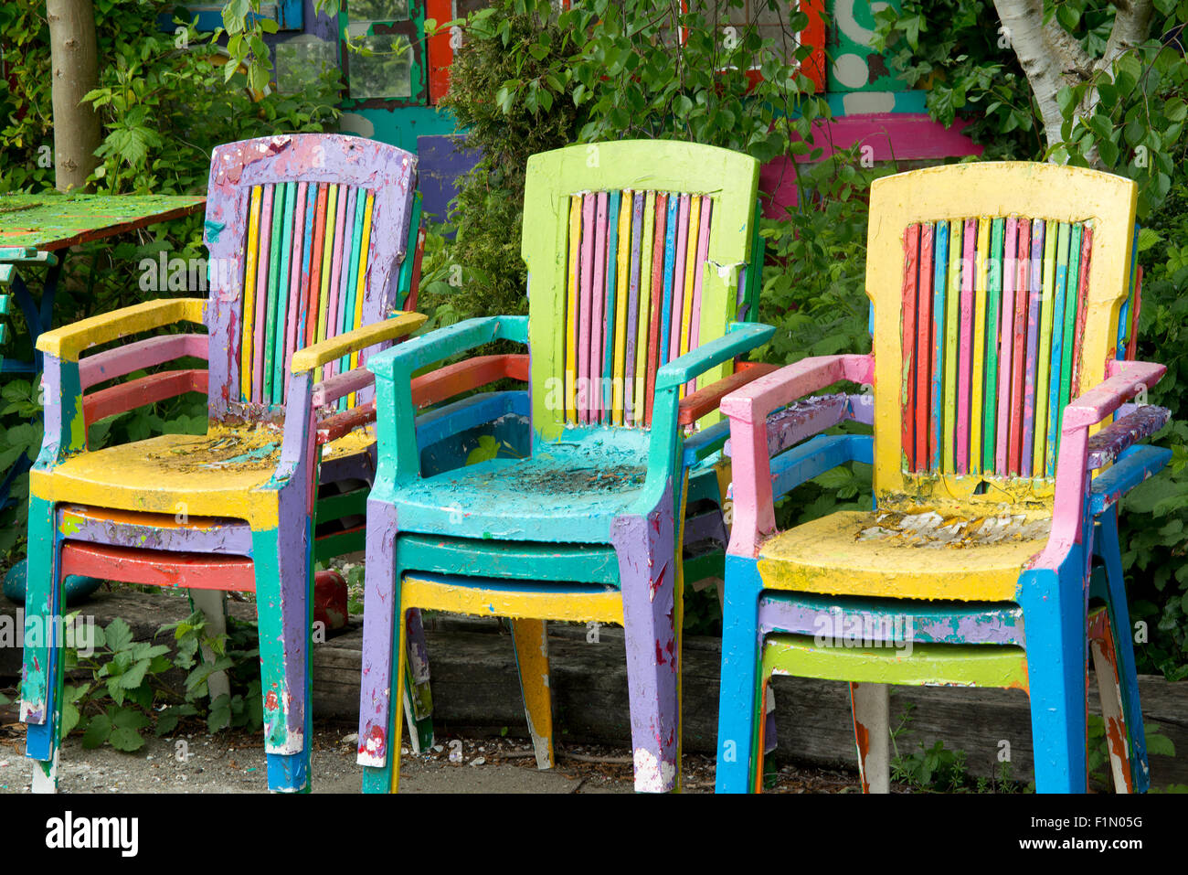 Colorful Painted Chairs In Garden