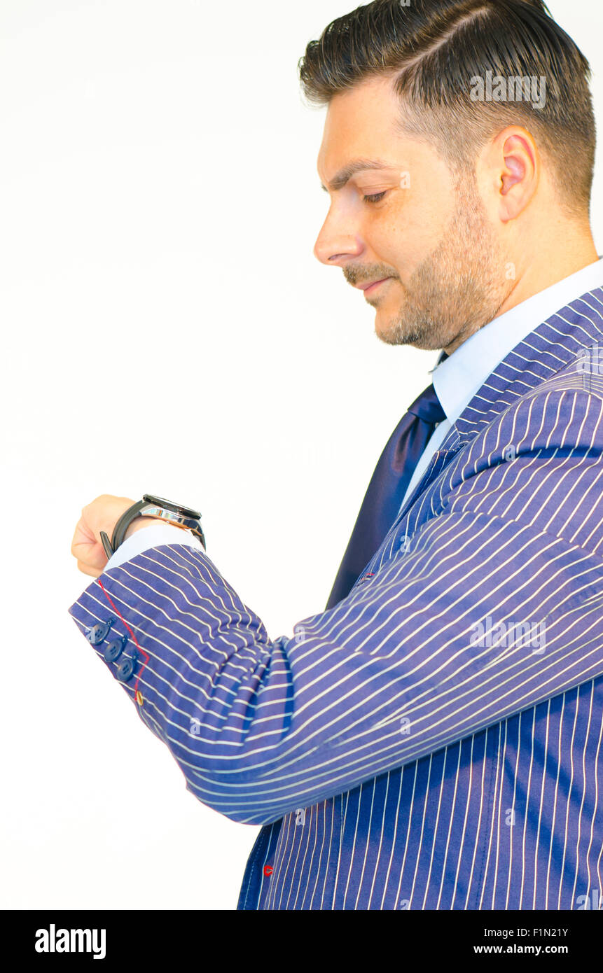 Business man looking at his watch islolated on white background - Stock Image