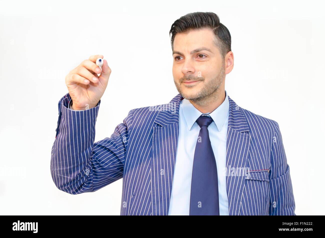 Business man writing with marker islated on white background - Stock Image