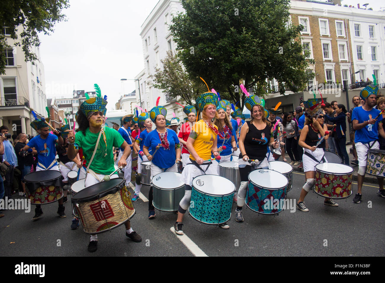 A musical group performing and playing drums on the first day of Notting Hill Carnival 2015 - Stock Image