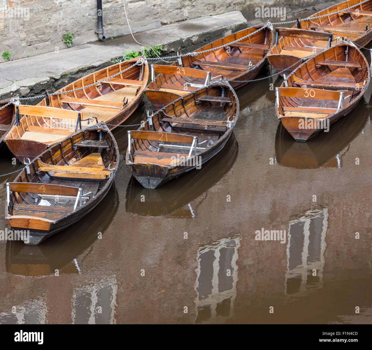 Rowboats for hire in the River Wear, Durham, England, UK. View from Leazes Road bridge with reflected building - Stock Image