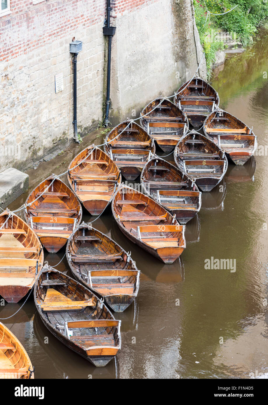 Rowboats for hire in the River Wear, Durham, England, UK. View from Leazes Road bridge - Stock Image