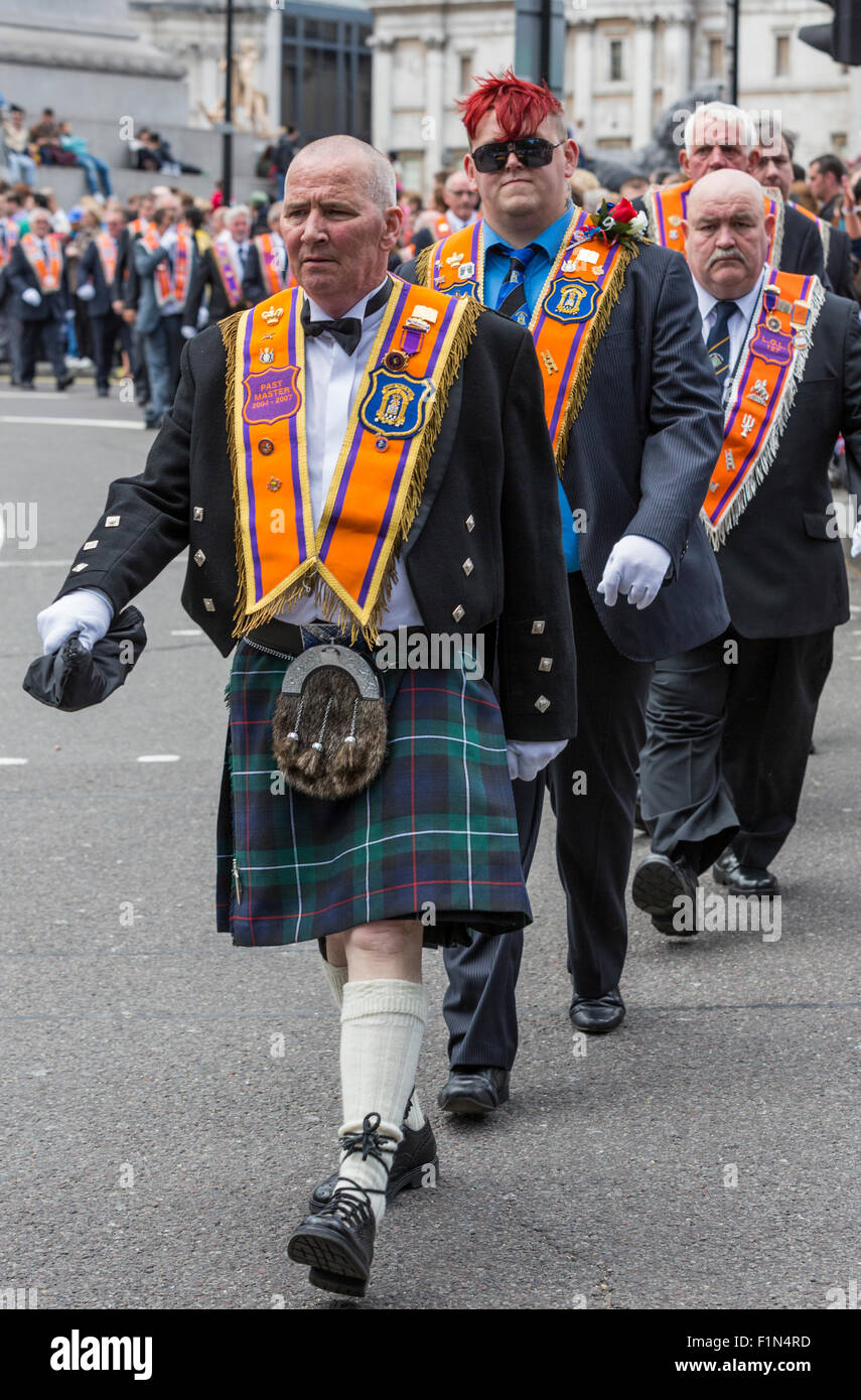 Loyal Orange Lodge members from Northern Ireland march through Trafalgar square on the day of the Trooping of the - Stock Image