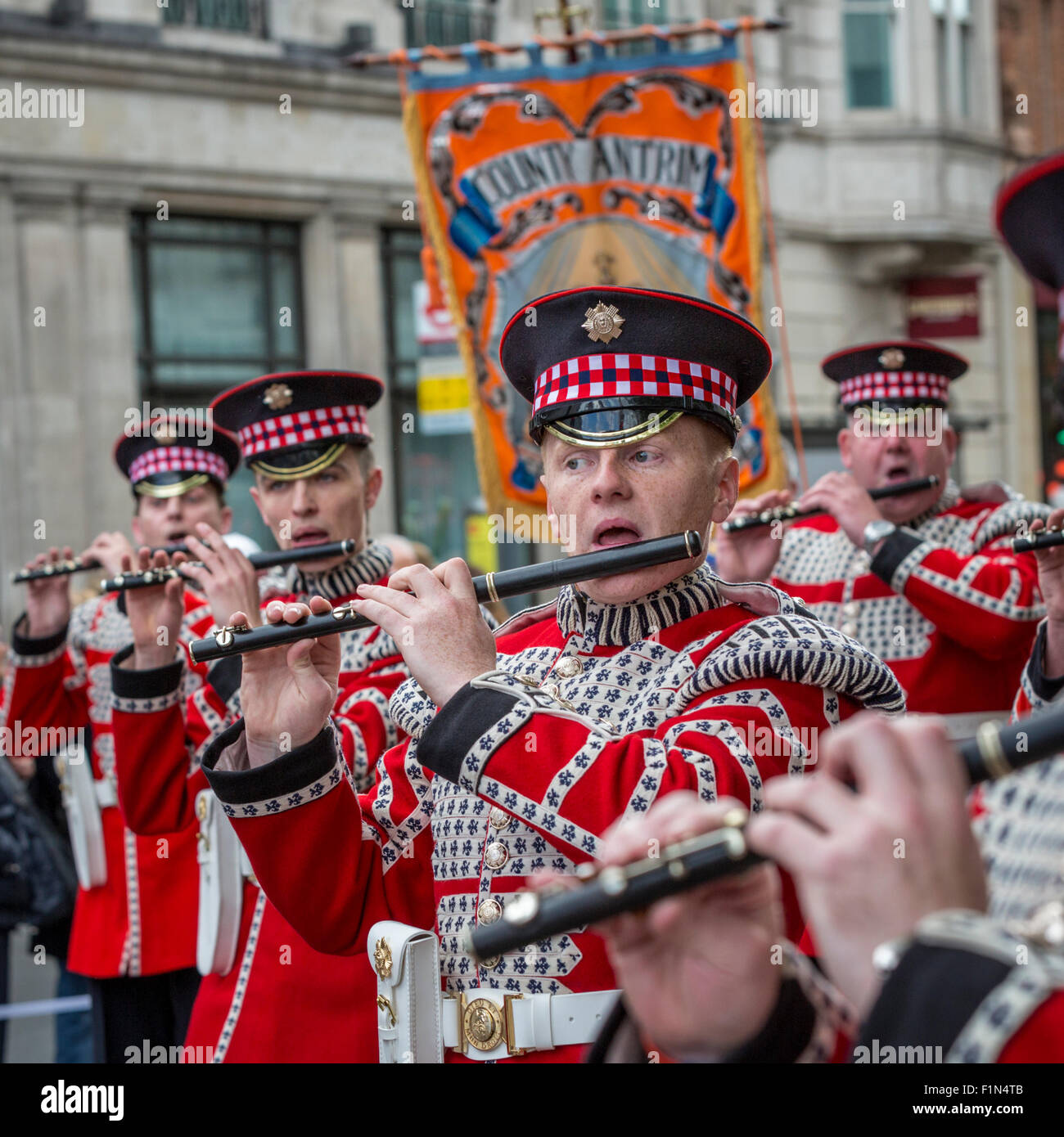 Red-clad Loyal Orange Lodge band marches through Trafalgar Square on the day of the Trooping of the Colours - Stock Image
