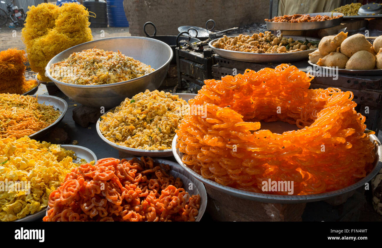 Sweet and savory snacks for sale at a stand in Sillod India on the road from the Ellora Caves to Aurangabad - Stock Image