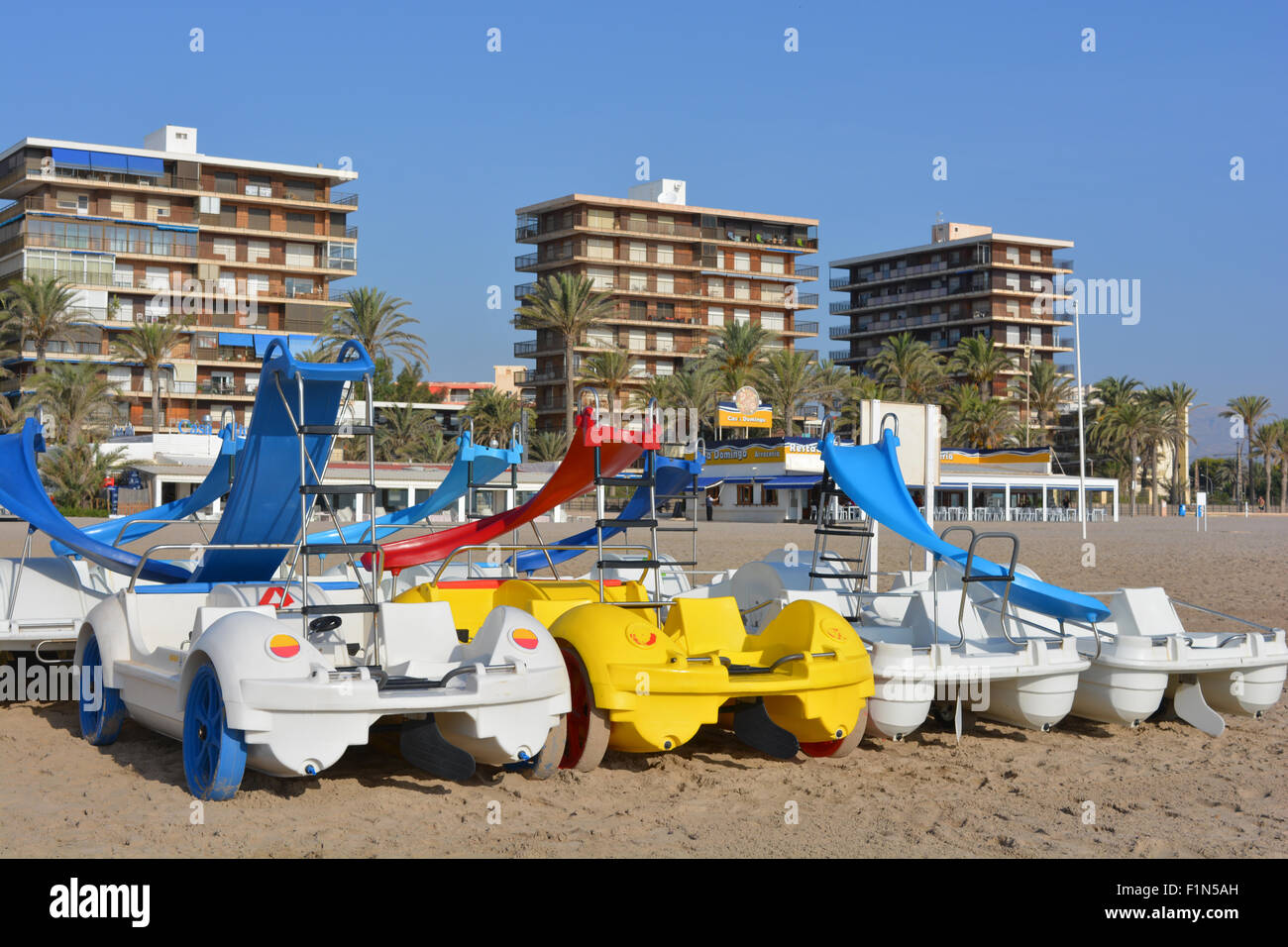 Apartments on the front and pedal boats for hire on the beach, San Juan Playa, Spain Stock Photo