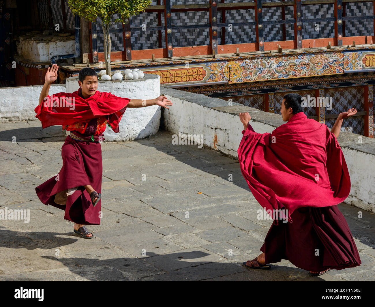 Monks at the temple in Bhutan - Stock Image