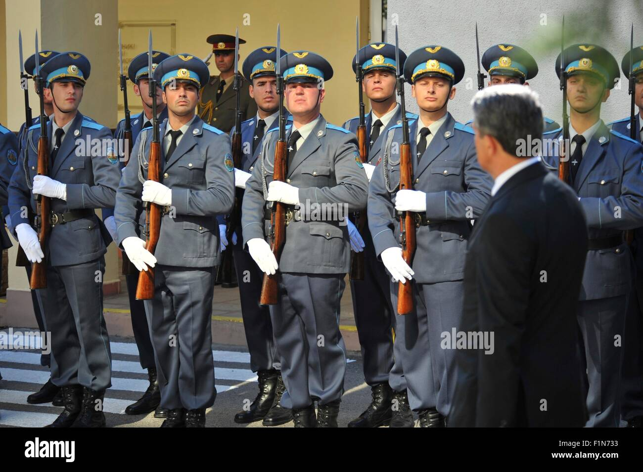 Members of the Bulgarian Armed Forces present arms to the President Rosen Plevneliev of Bulgaria during the NATO - Stock Image