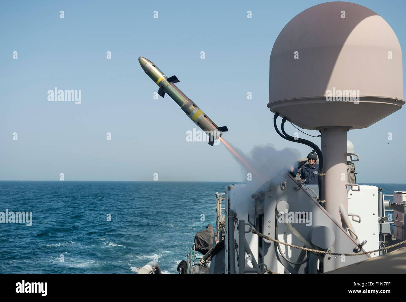 US Navy coastal patrol ship USS Firebolt fires a Griffin Missile during a test and proficiency fire June 28, 2015 - Stock Image