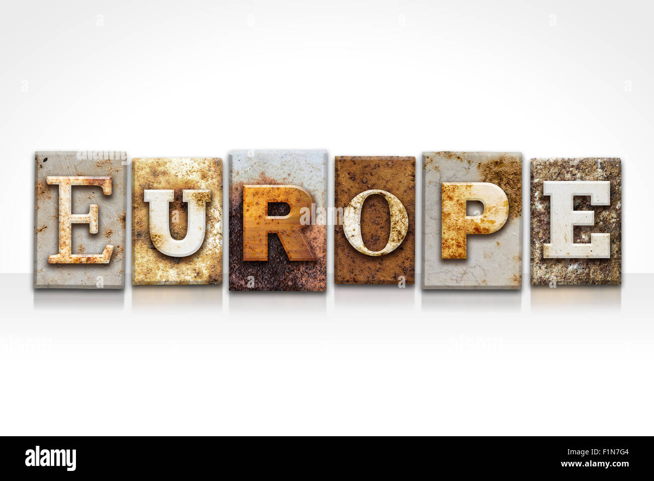 "The word ""EUROPE"" written in rusty metal letterpress type isolated ..."