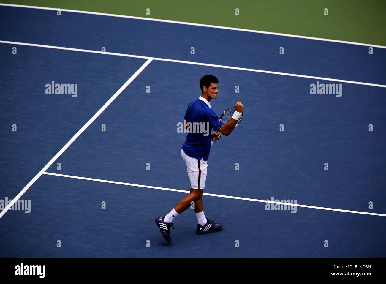 New York, USA. 4th September, 2015. Novak Djokovic reacts after winning a point during his third round match against - Stock Image