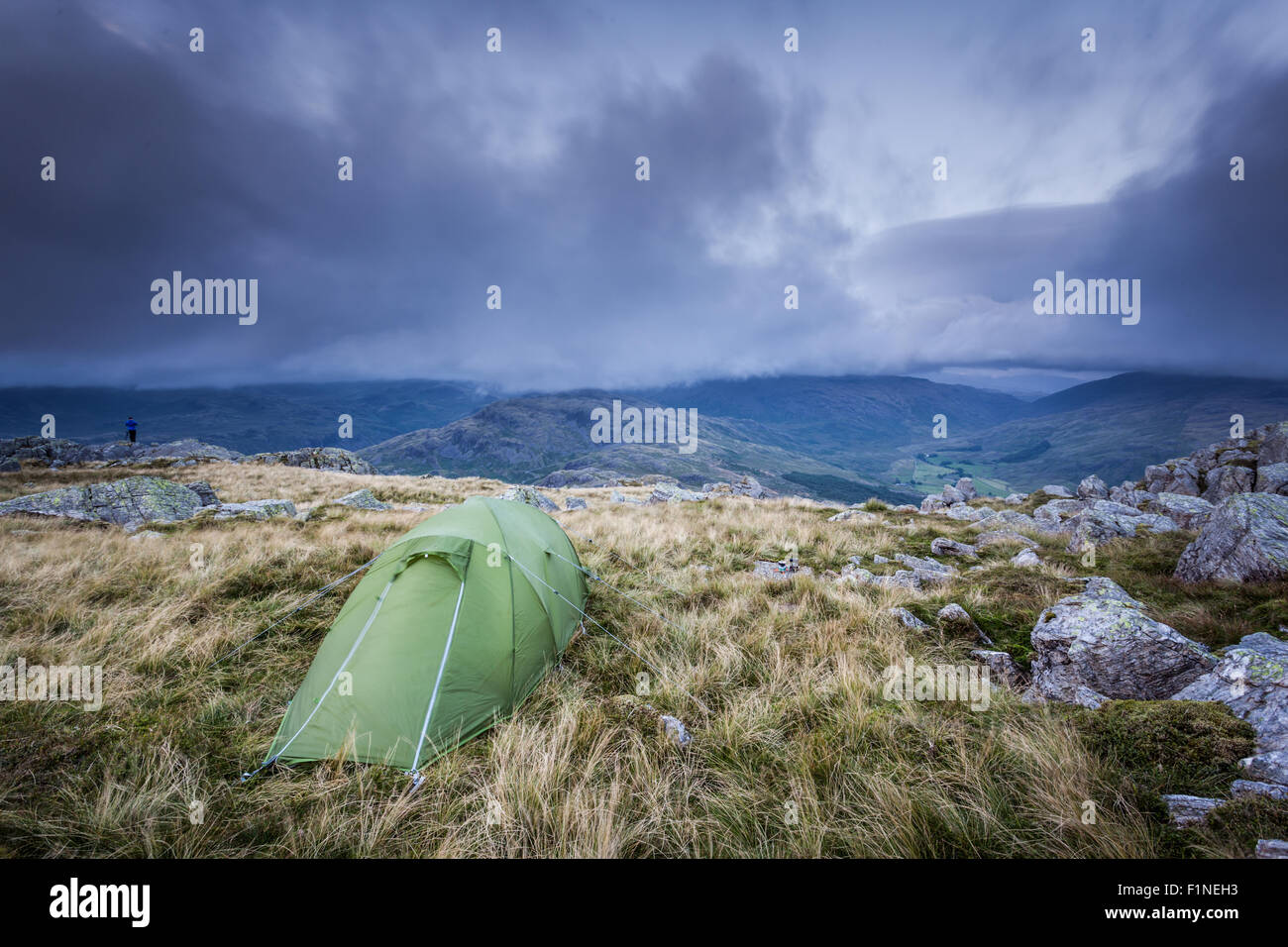 Harter Fell crags view across to the Scafells, English Lake District, wild camp at dusk - Stock Image