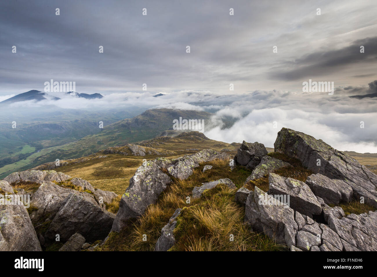 Harter Fell crags view across the the Scafells, English Lake District, a cloud inversion at sunrise - Stock Image