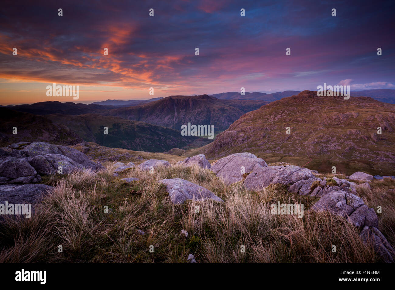 Harter Fell crags view across the Scafells, English Lake District - Stock Image