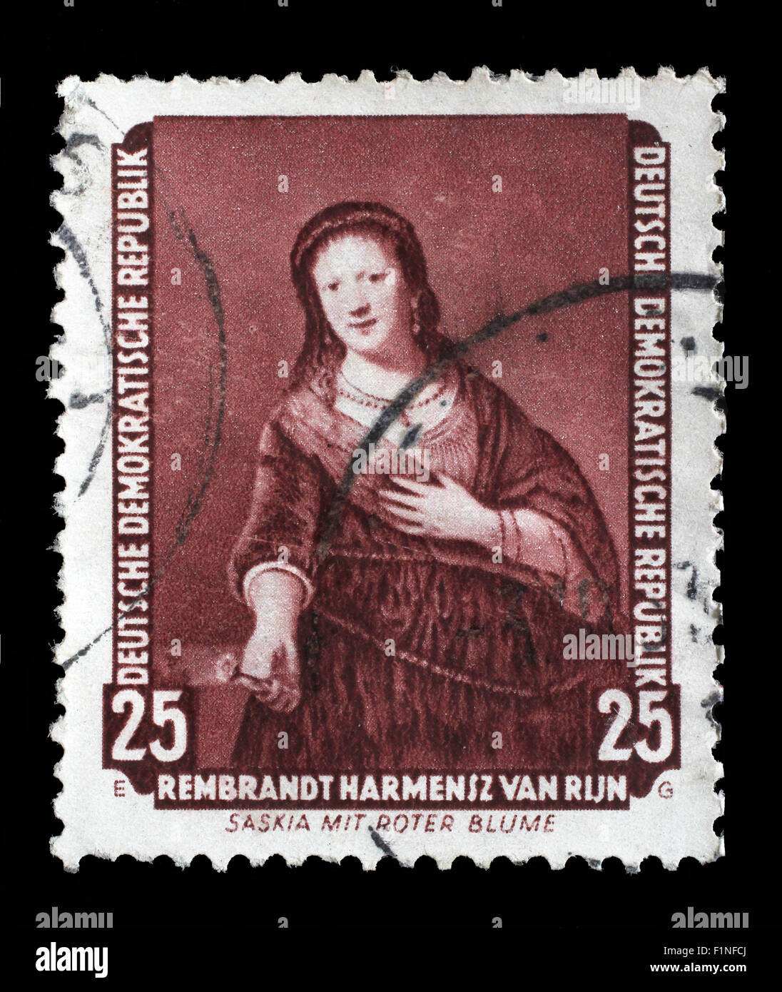 Stamp printed in DDR shows the painting Saskia with red flower, by Rembrandt, circa 1957. - Stock Image