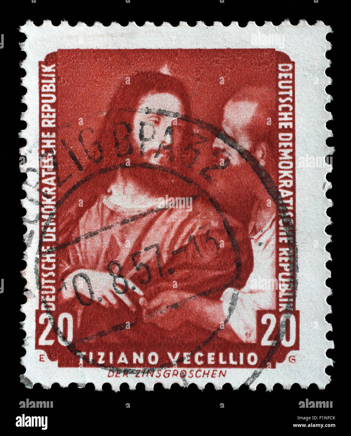 Stamp printed in DDR shows the painting Tax coppers, by Tiziano Vecellio , from the series Famous Paintings, circa - Stock Image