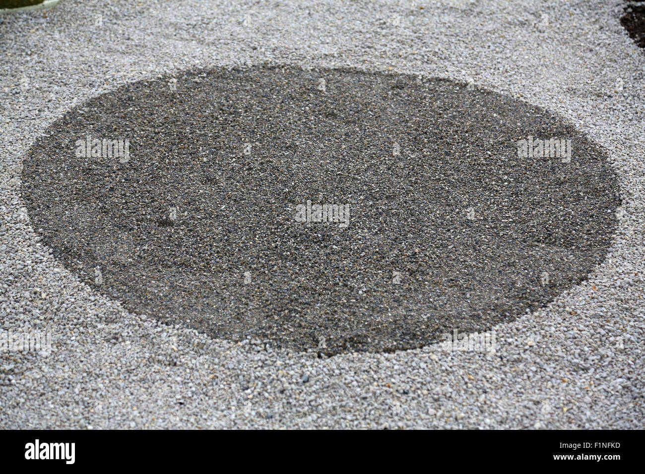Garden design, with hard landscaping, using shaping, paving, rocks and pebbles - Stock Image