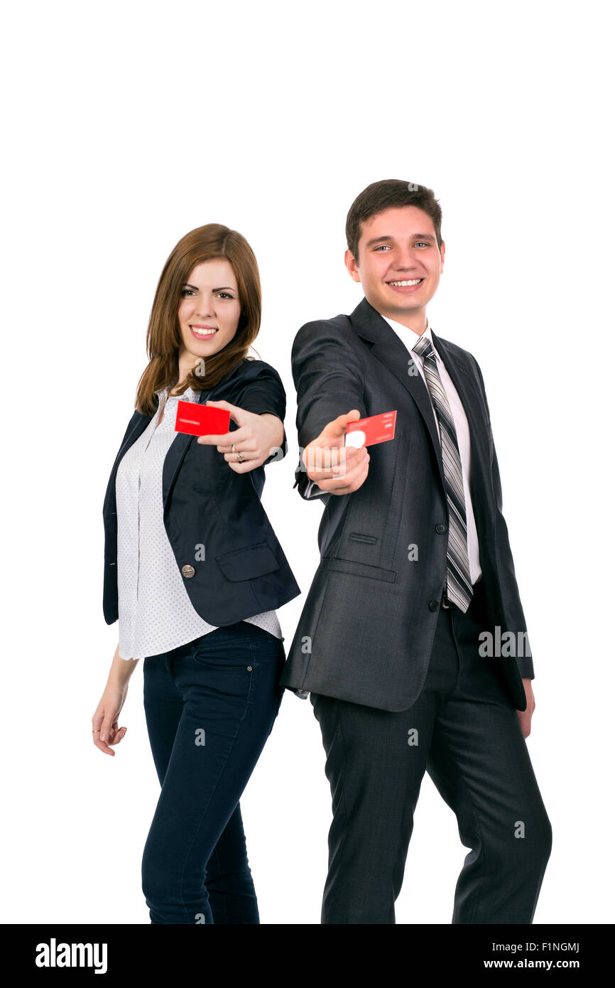 Smiling woman and man giving red business cards - Stock Image
