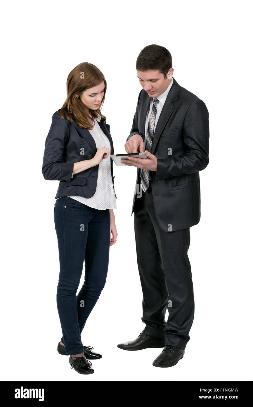 Male consultant explains features of electronic devise to female customer - Stock Image