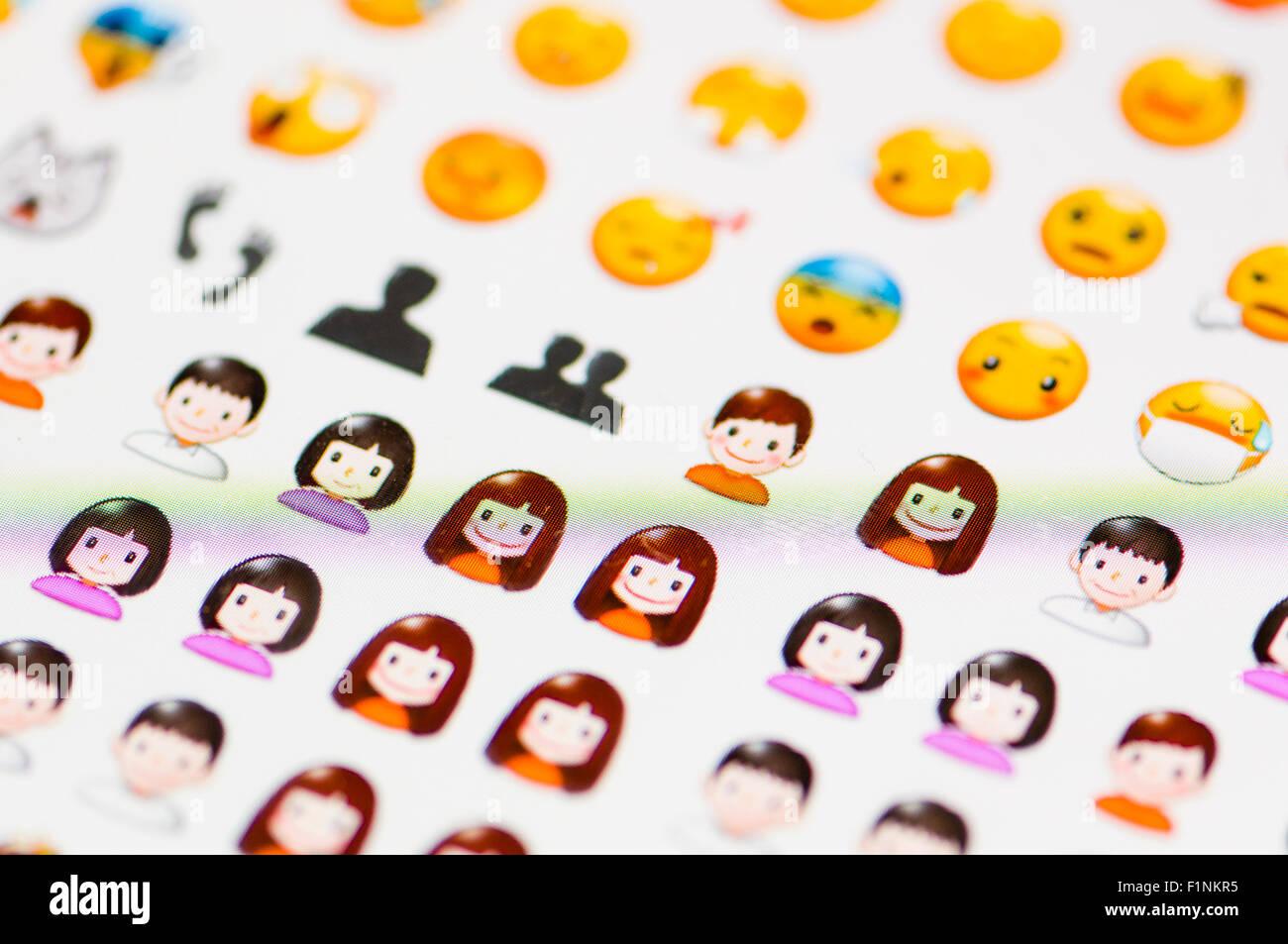 Screen displaying a range of people emojis - Stock Image