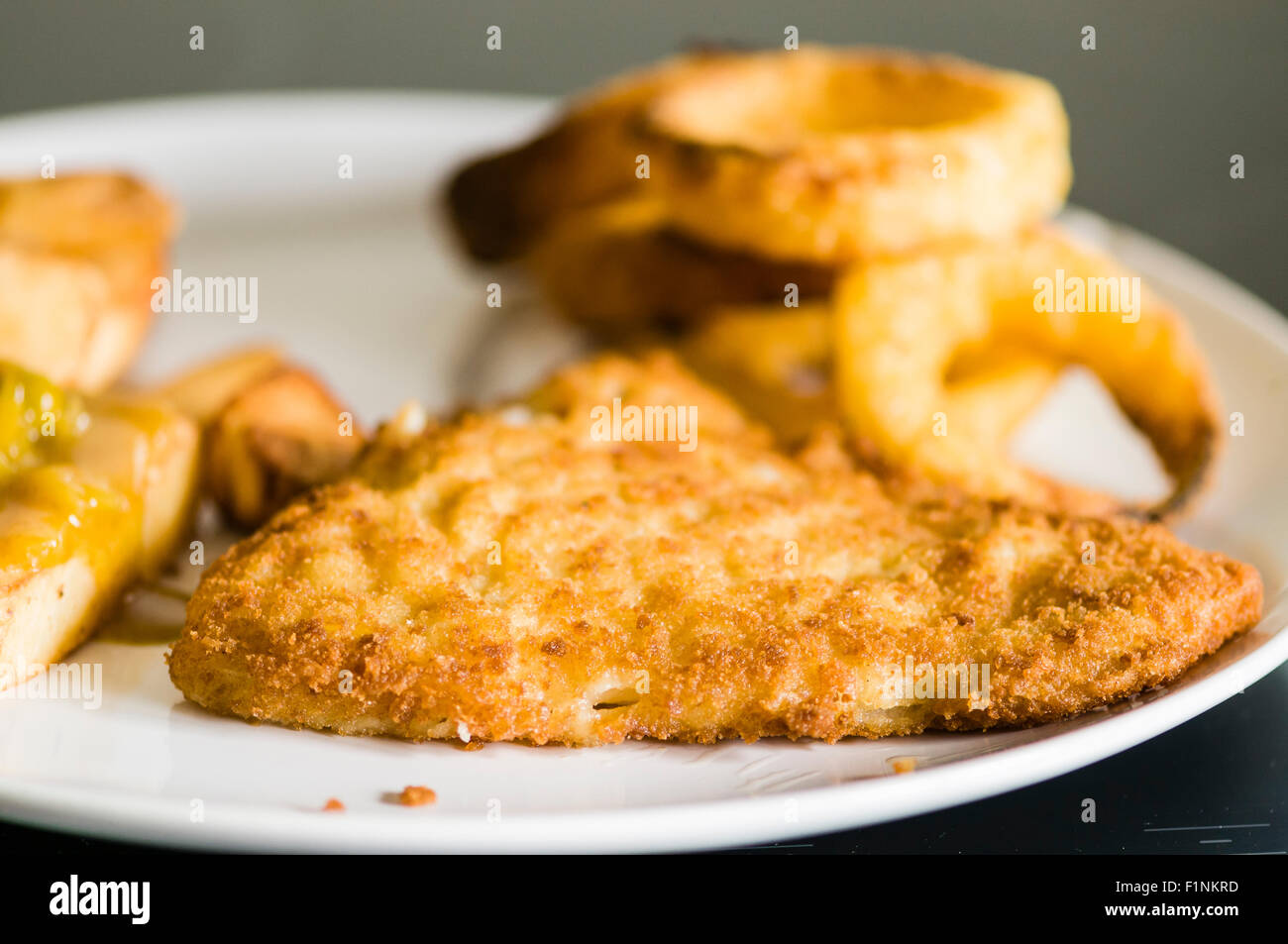Marks and Spencer gluten free breaded cod fish and chips with gluten free onion rings - Stock Image