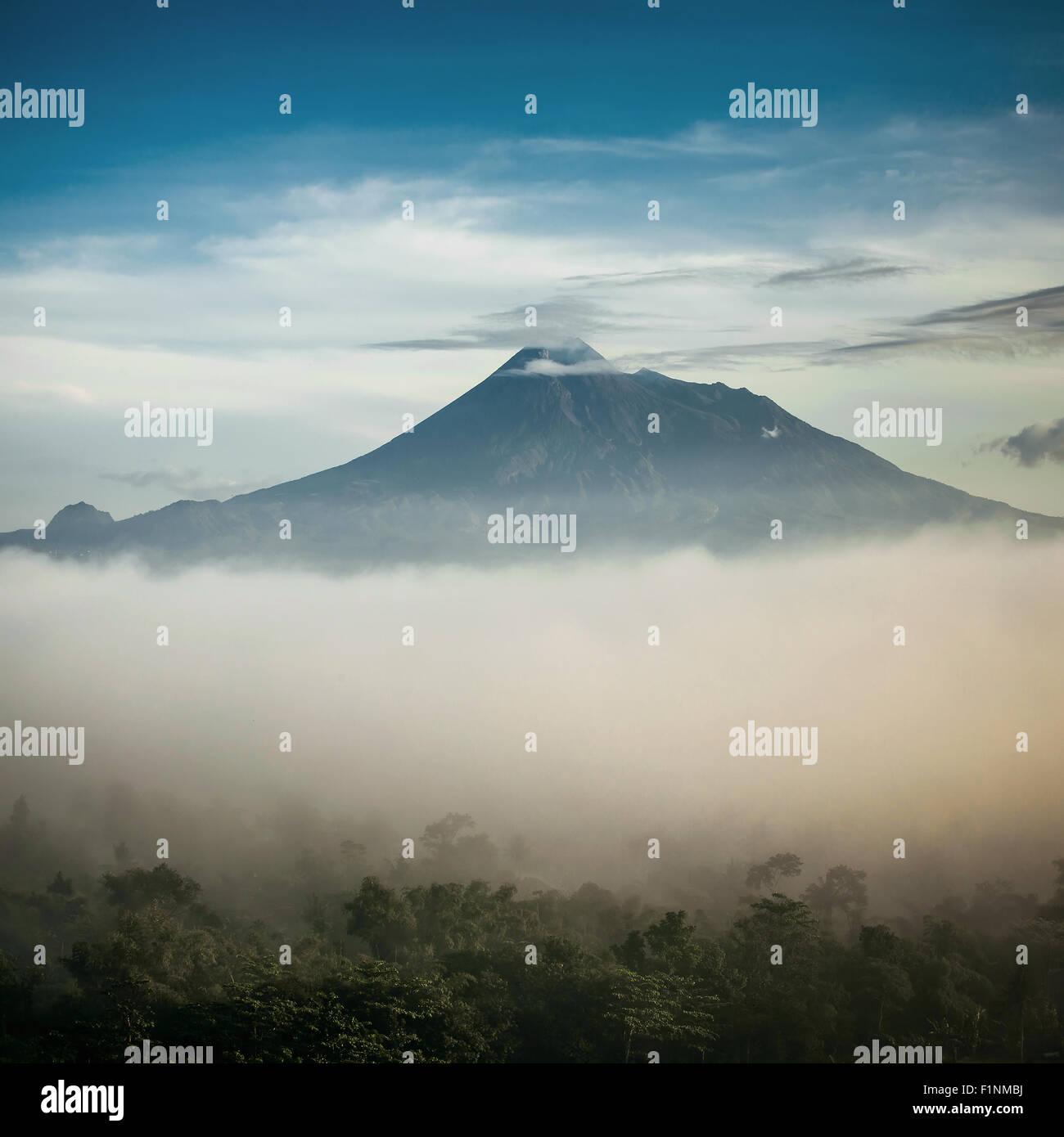 Mountain Merapi volcano, Java, Indonesia. Retro stylised photo - Stock Image