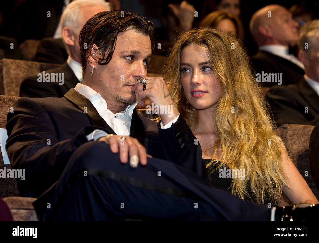 Actors Johnny Depp and Amber Heard attend the premiere of Black Mass