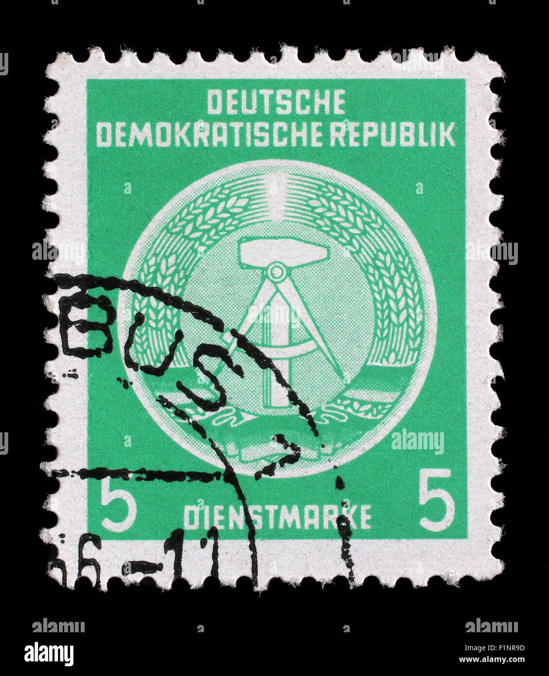 Stamp printed in GDR (German Democratic Republic - East Germany) shows DDR national coat of arms, circa 1952 Stock Photo