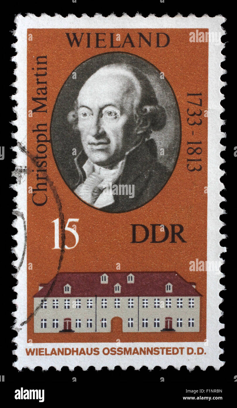 Stamp printed in the DDR (East Germany) shows Christoph Martin Wielandand and his house in Ossmannstedt, circa 1970 - Stock Image