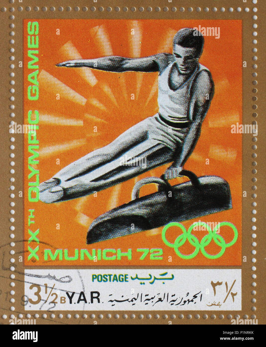 Stamp printed in Yemen Arab Republic shows gymnast on vaulting horse, Olympics in Munich, circa 1972 - Stock Image