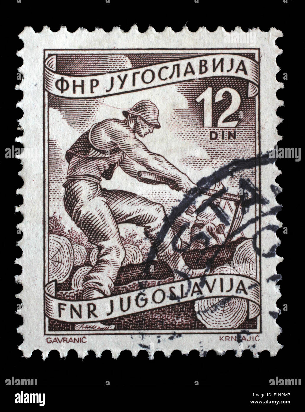 Stamp printed in Yugoslavia shows woodworker, domestic economy Series, circa 1952 - Stock Image