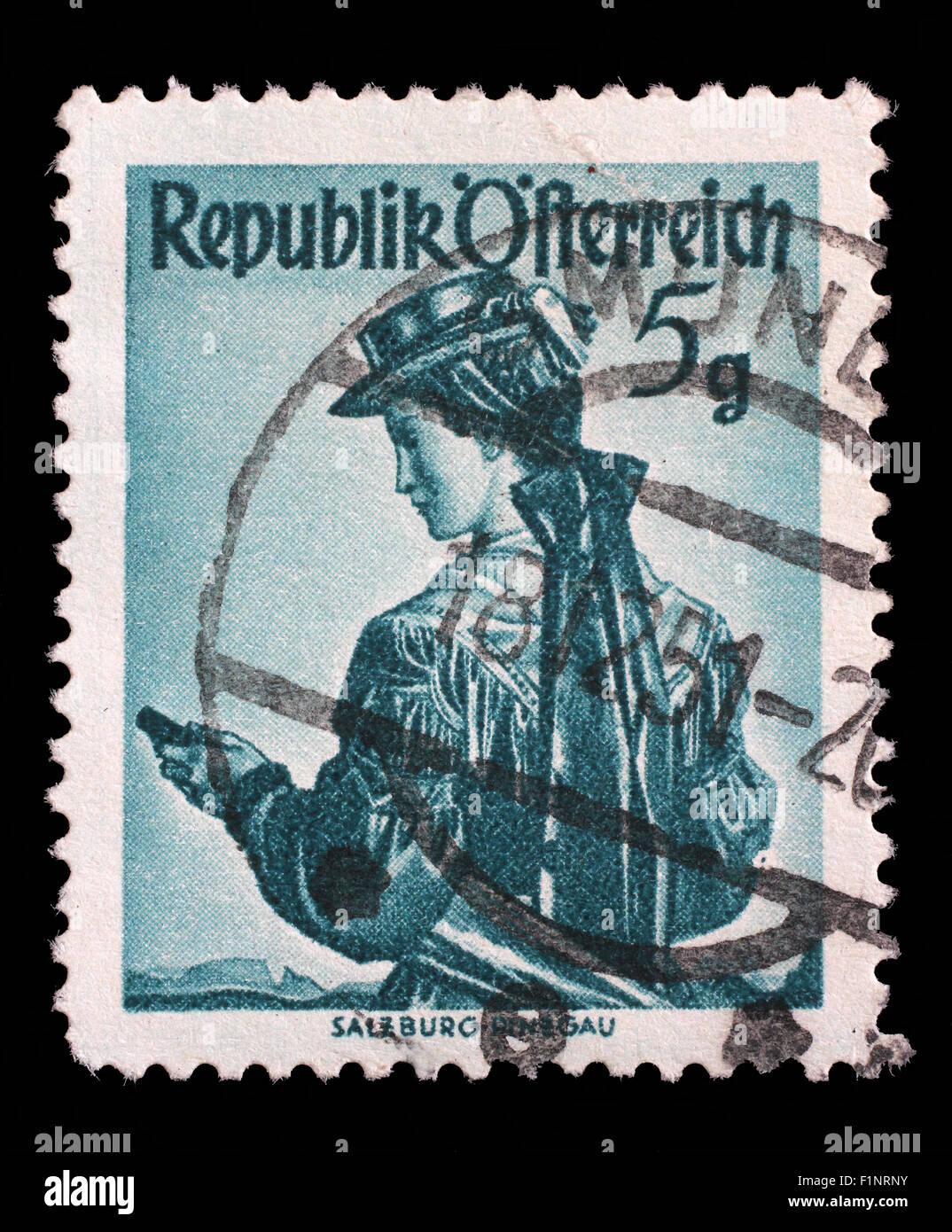 Stamp printed in the Austria shows Woman from Salzburg, Pinzgau, Regional Costume, circa 1949 Stock Photo