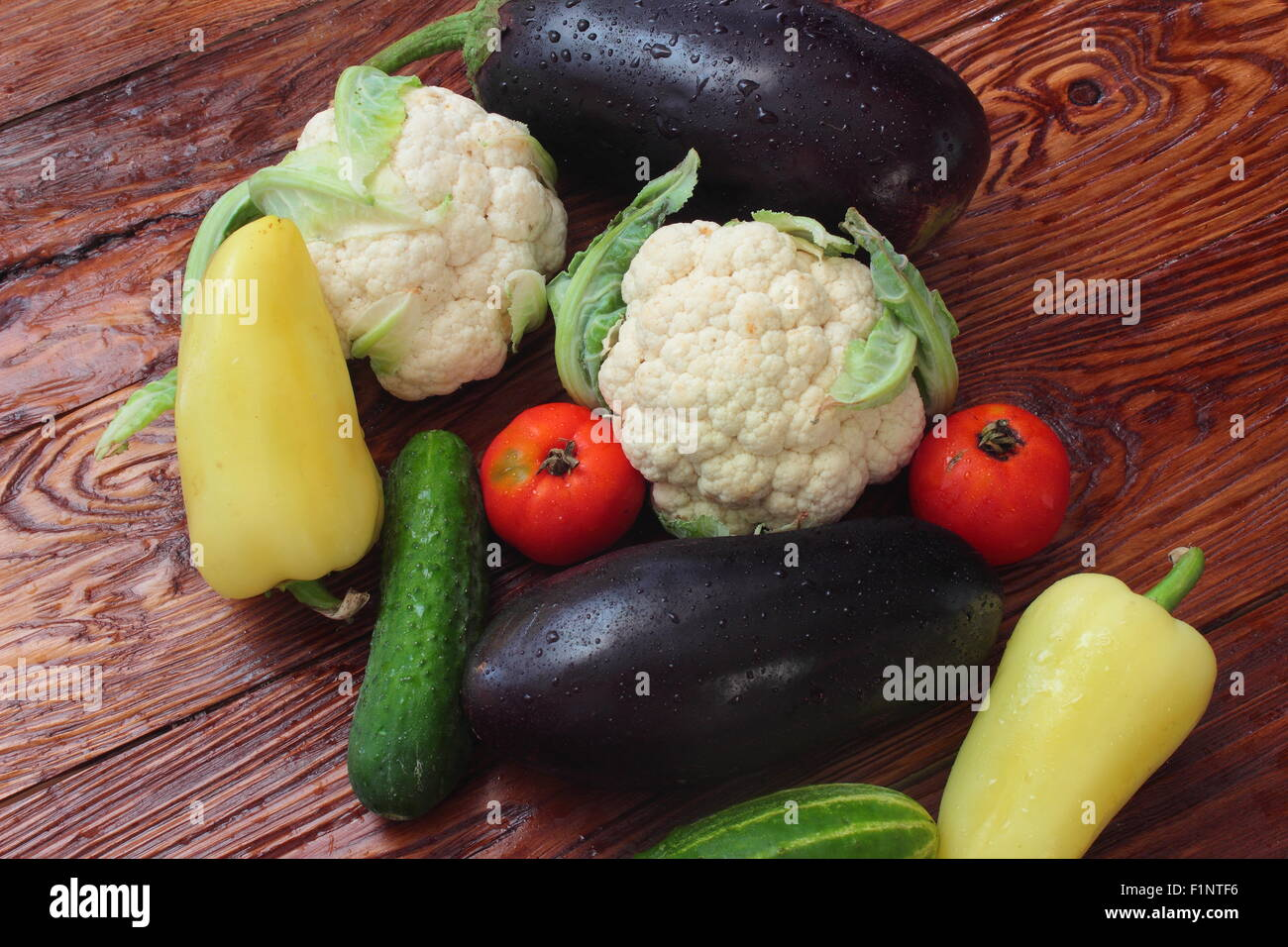 are bell peppers, cucumbers, eggplant, tomatoes, cauliflower - Stock Image