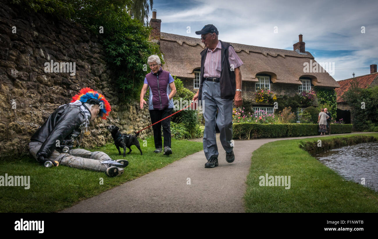 Picturesque thatched cottage in the quaint village of Thornton-le-Dale in North Yorkshire during the Scarecrow Walk - Stock Image