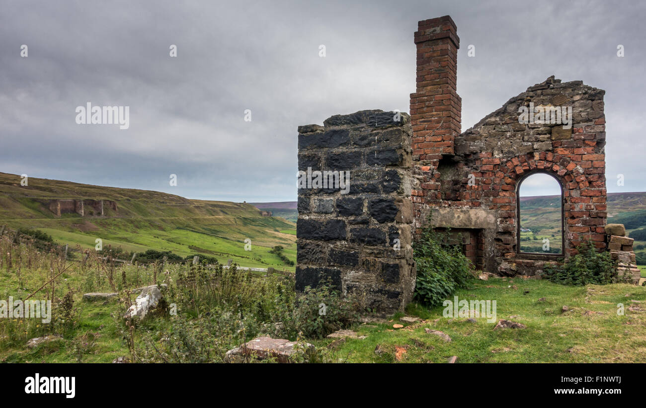 A ruined miner's cottage; industrial heritage from the old railway line of the nineteenth century ironstone - Stock Image