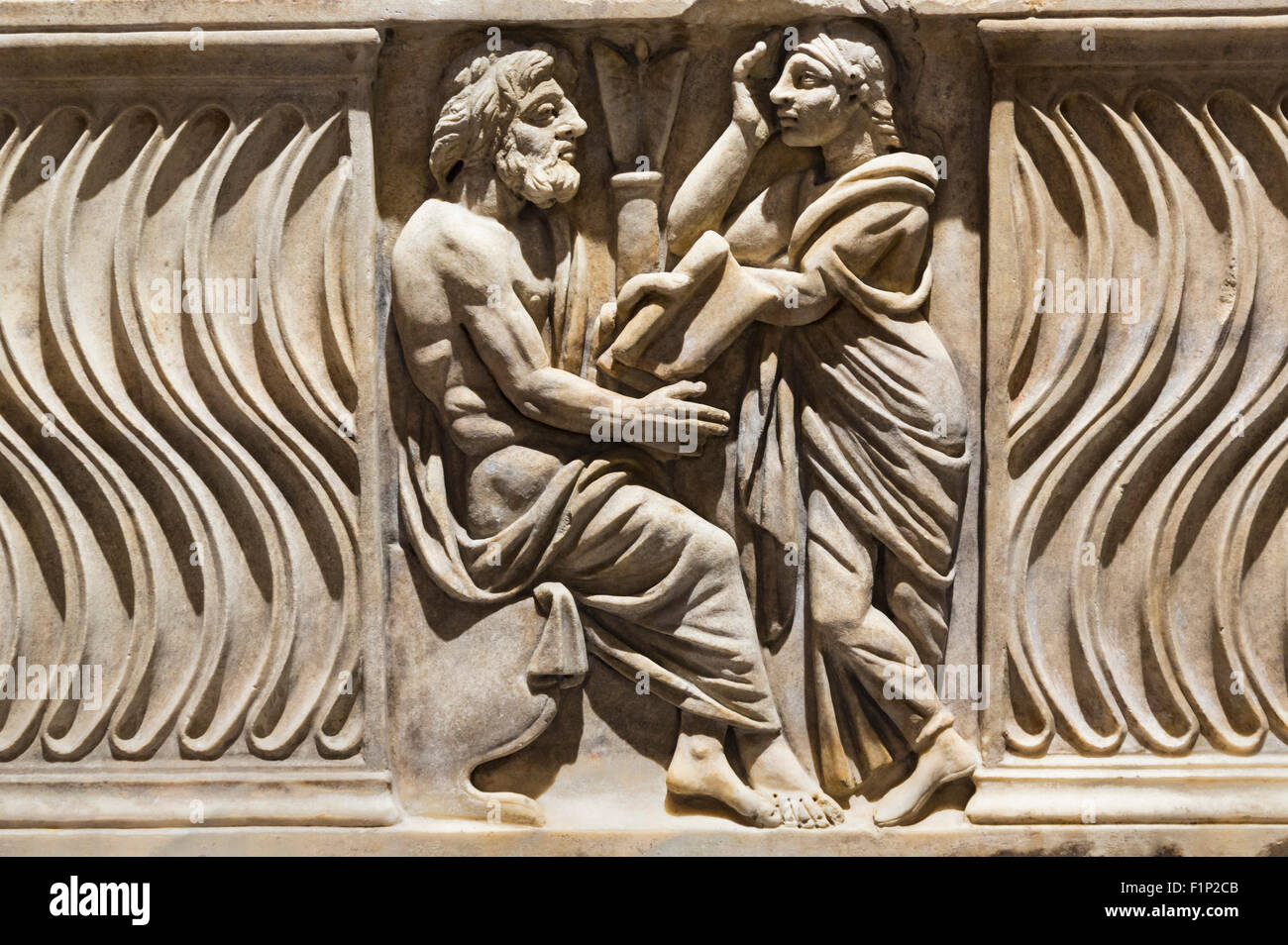 Rome, Italy.  Decoration on a sarcophagus with image of philosopher and muse. Late 3rd-4th century AD. - Stock Image